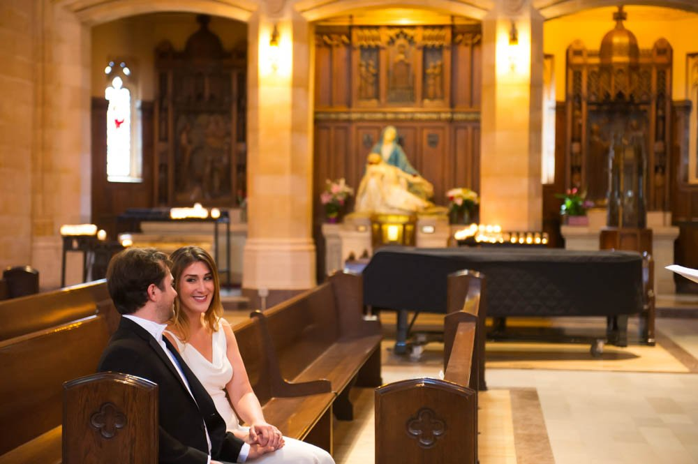 Bride and Groom sitting in the pew at Saint Dominic's Church in San Francisco