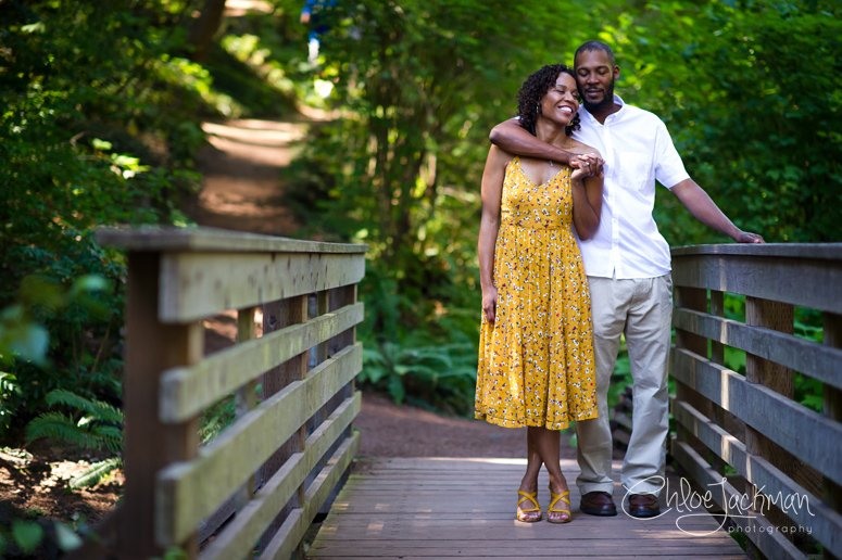 couple standing on a bridge at their Tilden Park Engagement session