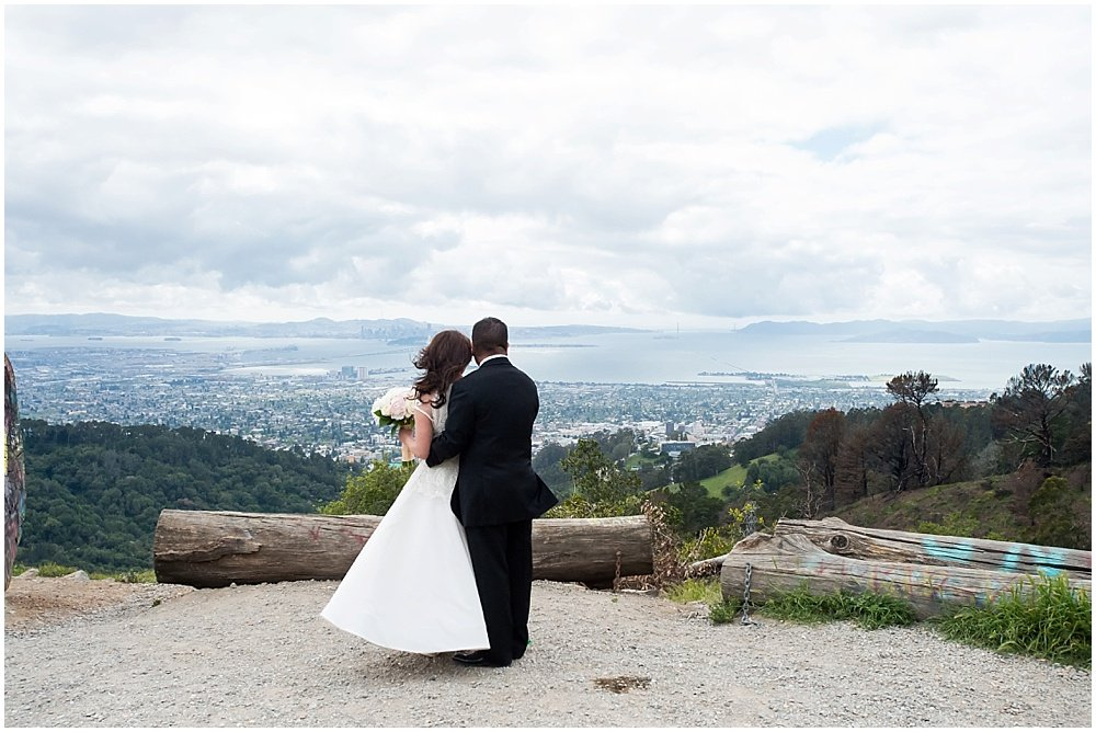 Bride and groom look out over scenic San Francisco view by chloe jackman photography