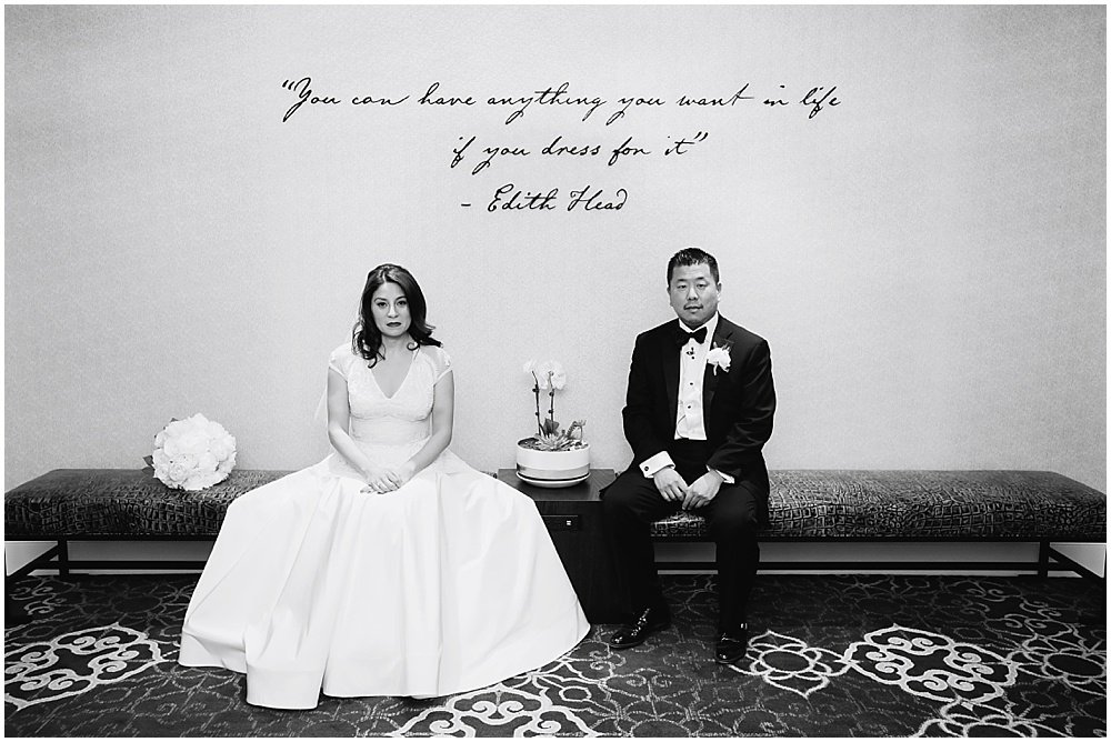 Bride and groom sit under a quote before claremont hotel wedding by Chloe Jackman Photography