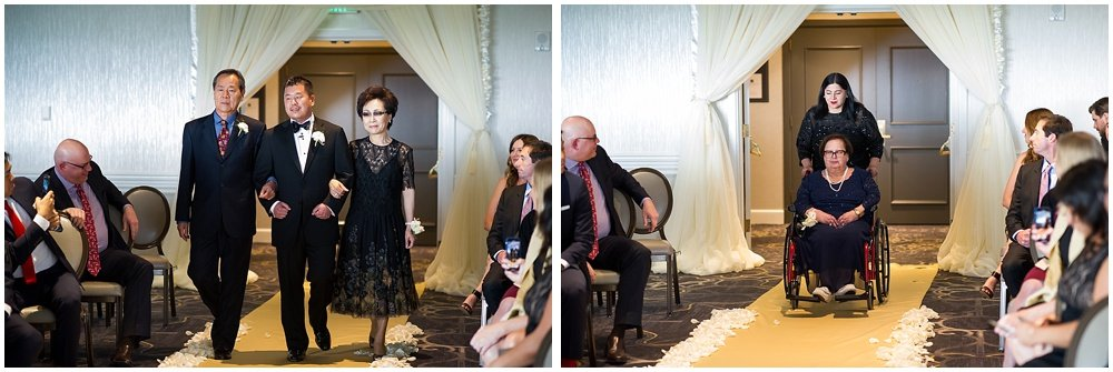Groom gets walked down the isle by parents at Claremont Hotel Wedding