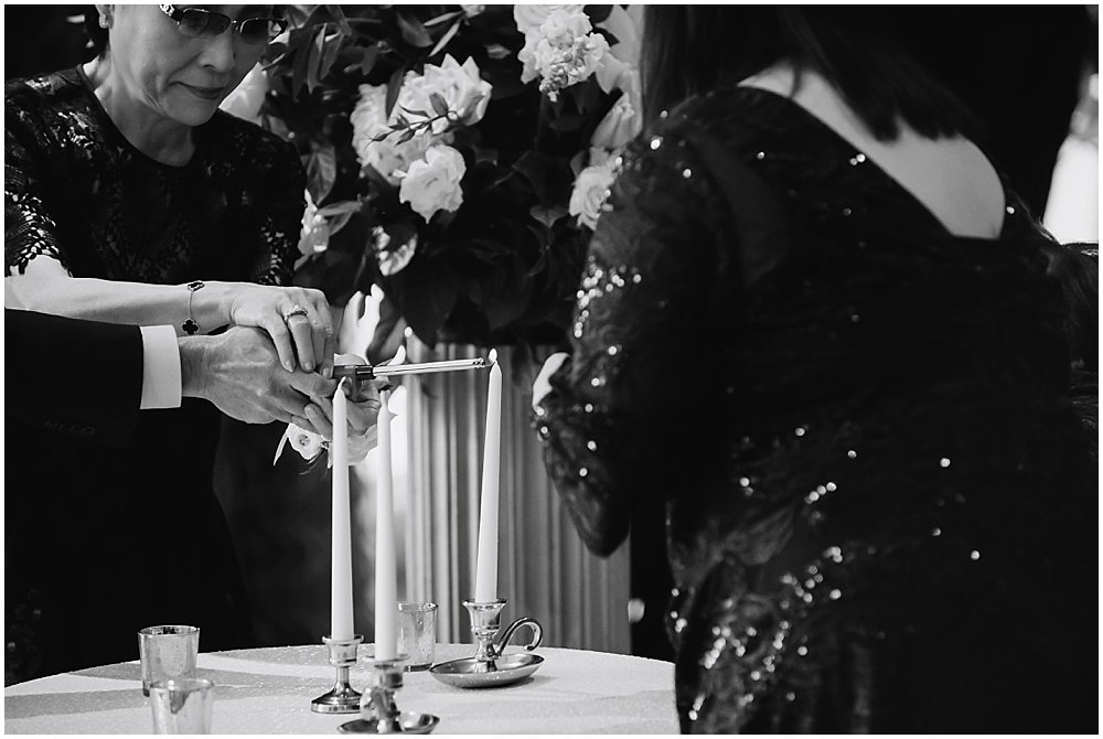 mothers of bride and groom light a unity candle at claremont hotel wedding