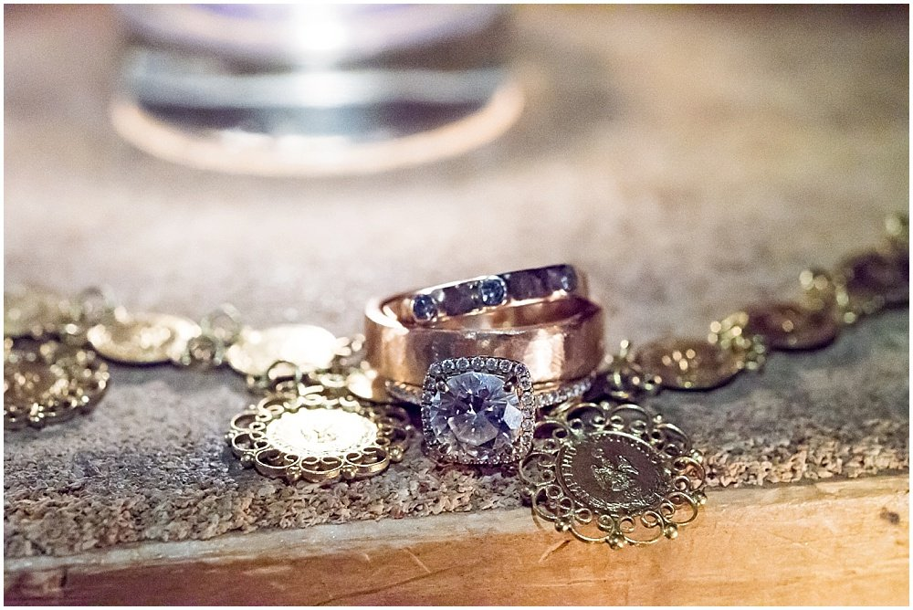 Wedding bands and necklace close up at General's Daughter Wedding by Chloe Jackman Photography
