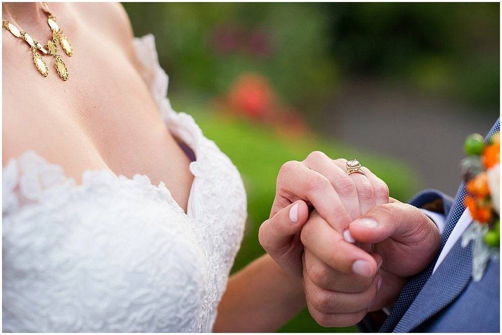 holding hands at General's Daughter wedding by Chloe Jackman Photography