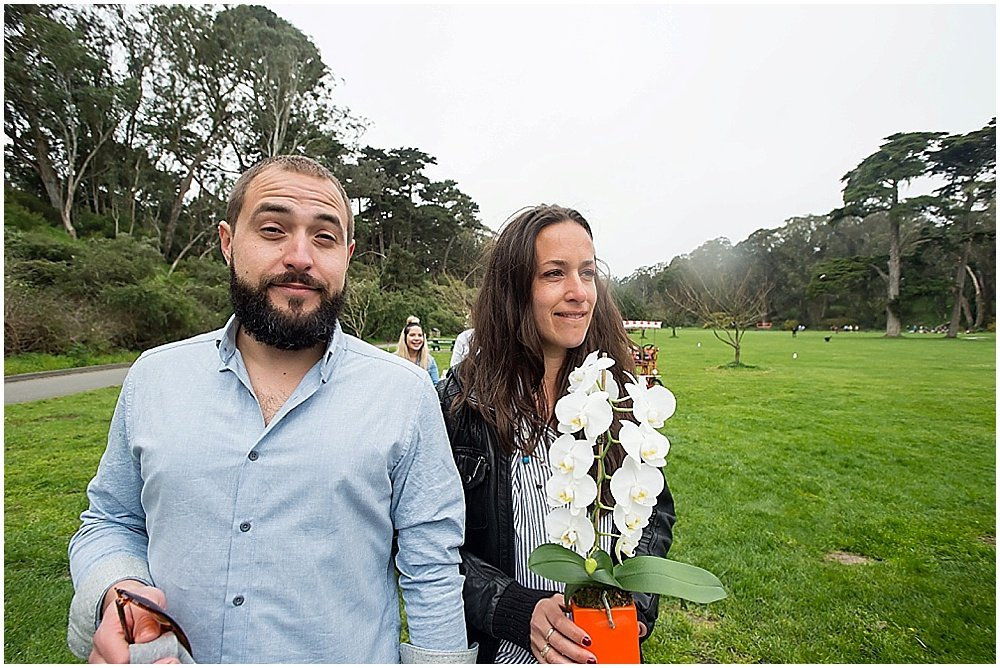 Bride and groom walk to cherry blossom altar in golden gate park wedding