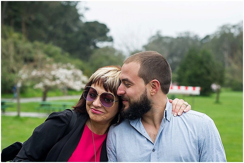 Groom smiles at guest at golden gate park wedding by chloe jackman photography