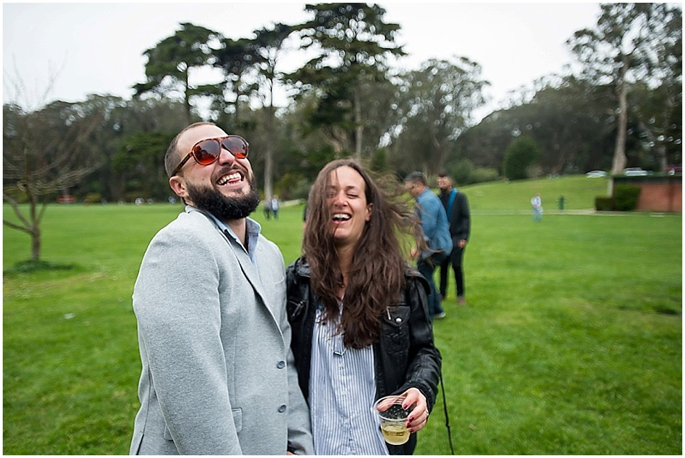 Bride and Groom candid of laughing at golden gate park wedding by chloe jackman photography
