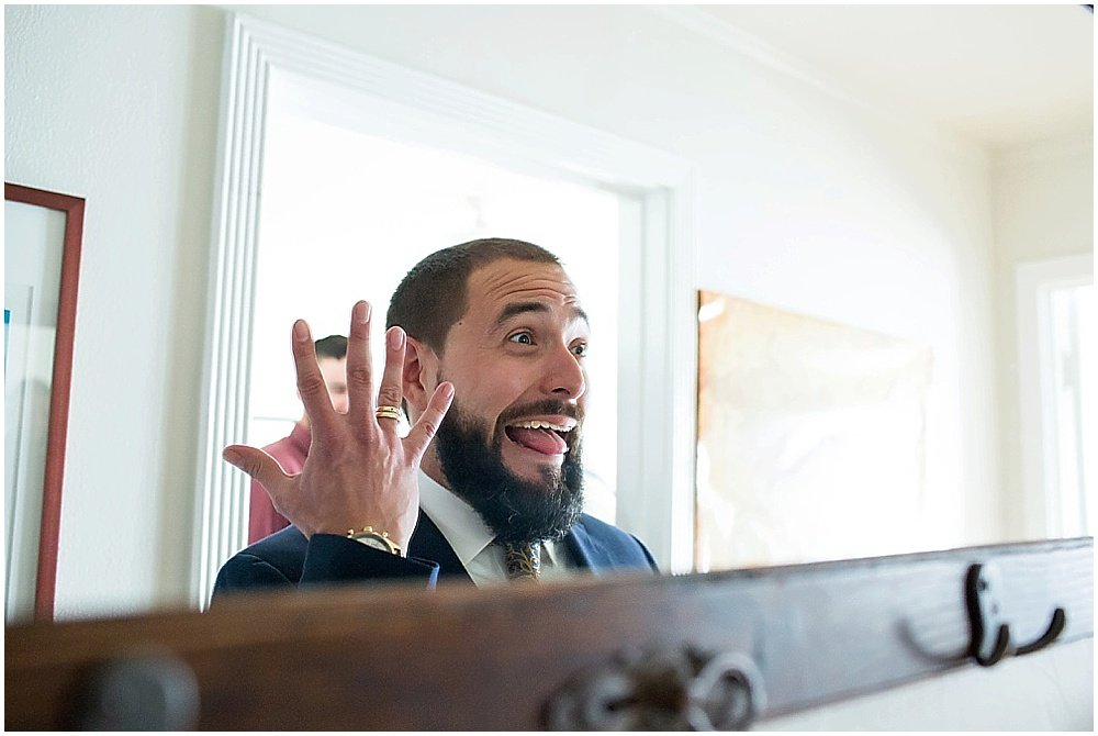 Groom displays ring excitedly at the commissary wedding in san francisco by chloe jackman photography