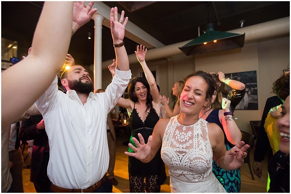 Bride and groom are in the center of the dance circle at the commissary wedding in san francisco by chloe jackman photography