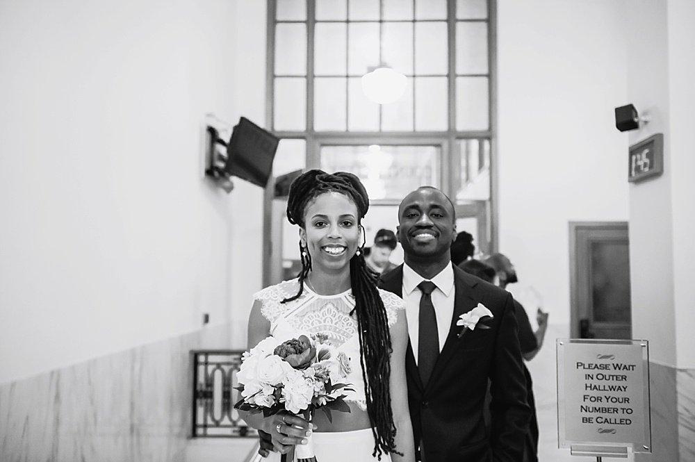 Happy bride and groom at San Francisco City Hall Small Wedding black wedding photographer in san Francisco
