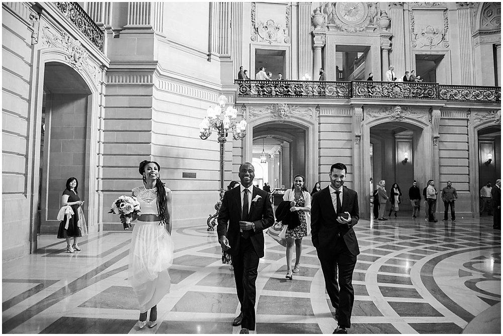 Bride and groom walk into San Francisco City Hall Small Wedding