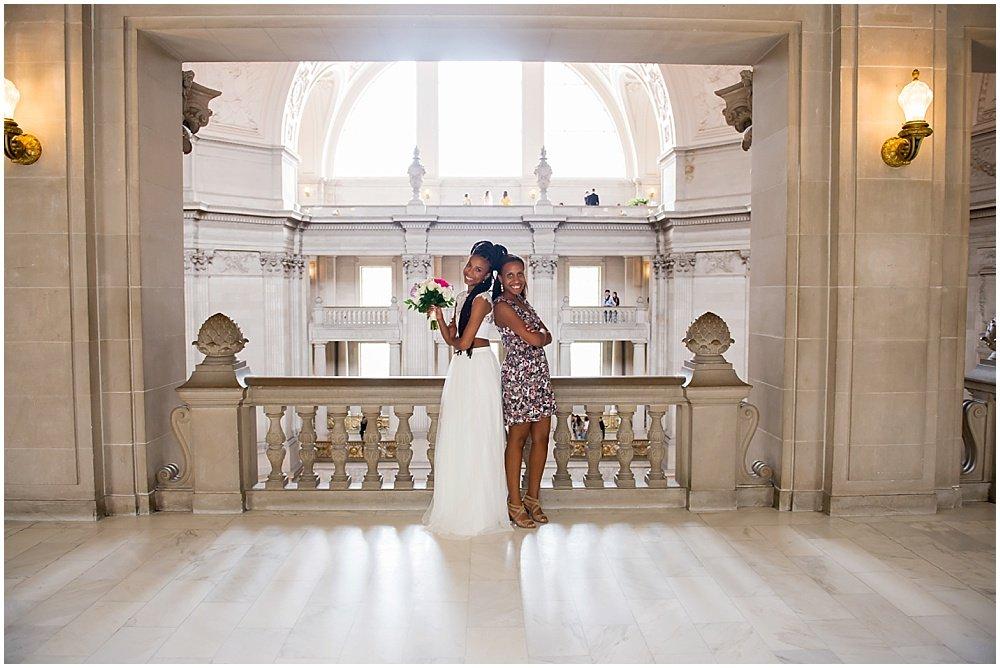 Bride and maid of honor back to back at San Francisco City Hall Small Wedding
