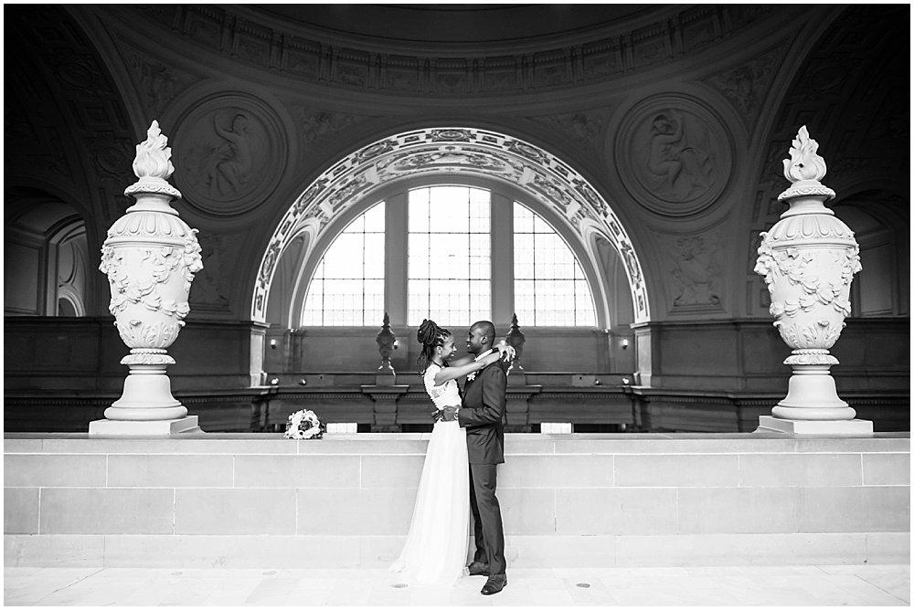 Bride and groom at San Francisco City Hall Small Wedding black wedding photographer in san Francisco
