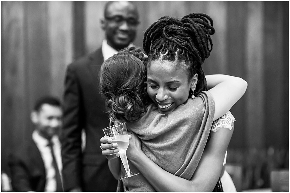 Bride hugs maid of honor by chloe jackman photography black wedding photographer in san Francisco