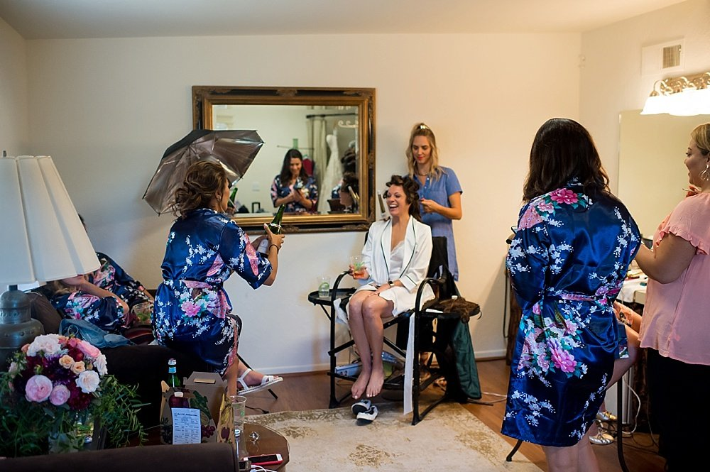 Bride getting hair done at hans fahden winery wedding
