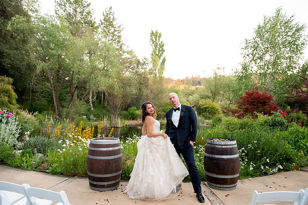 Bride and groom pose after hans fahden winery wedding by chloe jackman photography