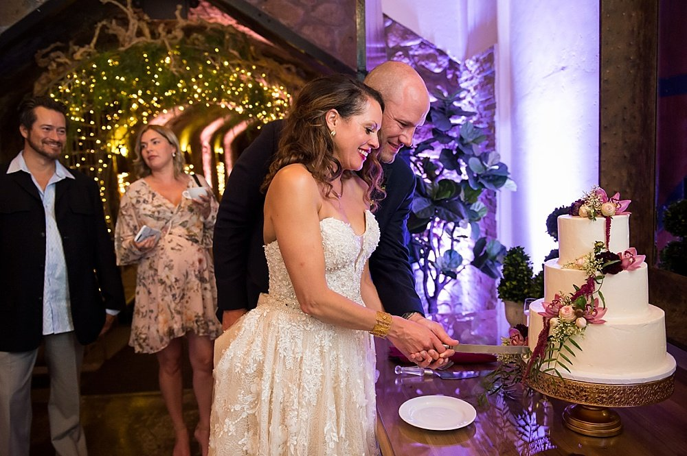 Bride and groom cut their wedding cake at hans fahden winery wedding by chloe jackman photography