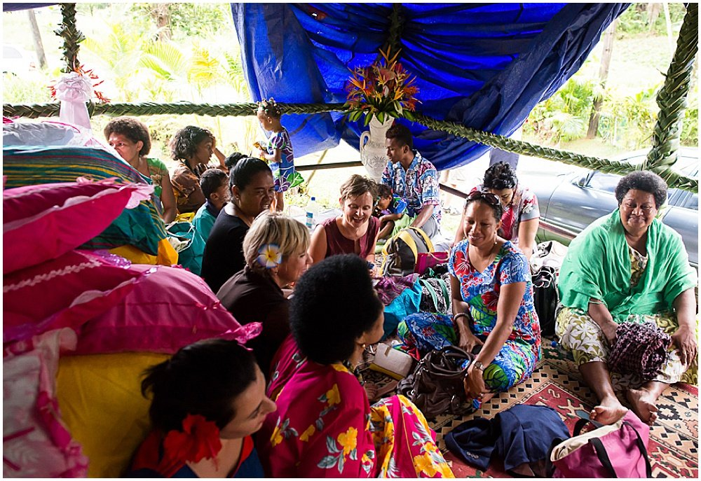 Friends and family of the bride gathered together awaiting for her arrival during the Traditional Fijian Wedding by Chloe Jackman Photography