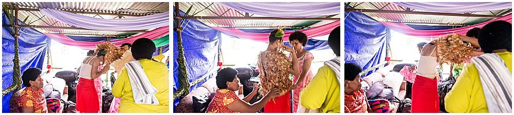 dressing the bride in a traditional feathered garment top for Traditional Fijian Wedding by Chloe Jackman Photography.