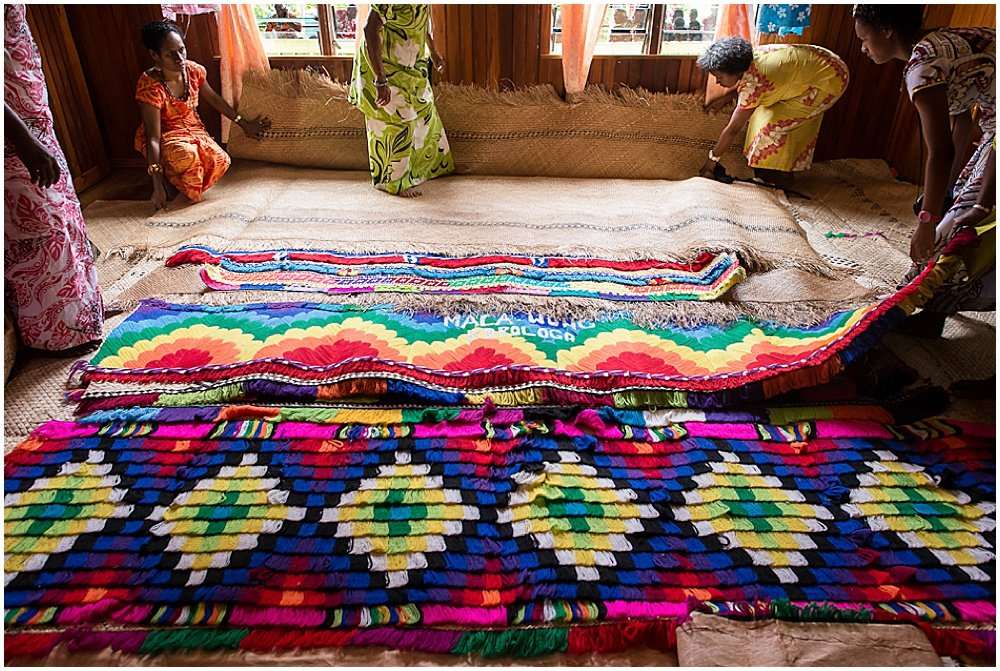 Colorful straw mats placed on the floor in preparation of the ceremonial room during Traditional Fijian Wedding By Chloe Jackman Photography