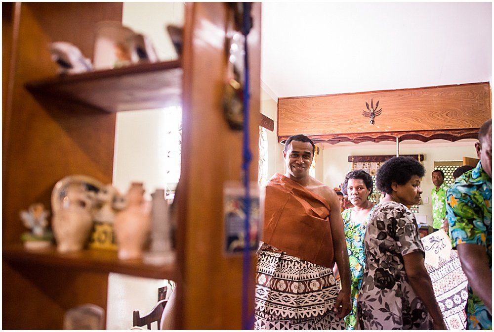 groom enters into the ceremonial room during the Traditional Fijian Wedding by Chloe Jackman Photography