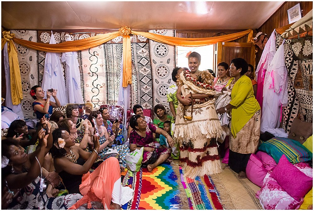 bride enters ceremonial room at Traditional Fijian Wedding By Chloe Jackman Photography
