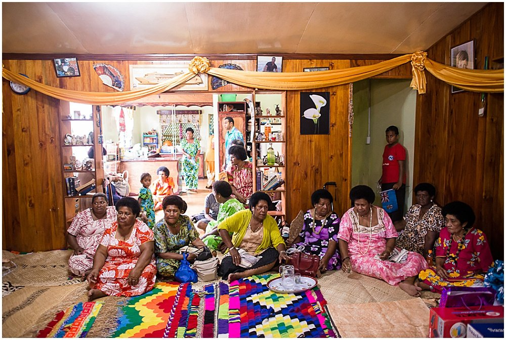 Elders gather at the central ceremonial room awaiting the Traditional Fijian Wedding by Chloe Jackman Photography
