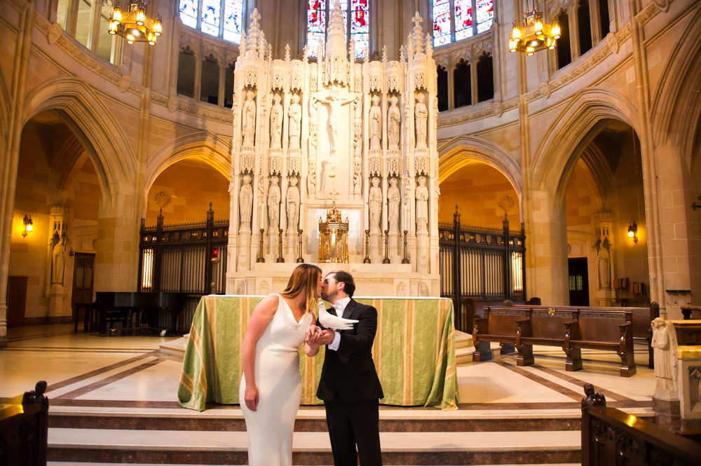 Bride and Groom kissing inside of Saint Dominic's Church in San Francisco
