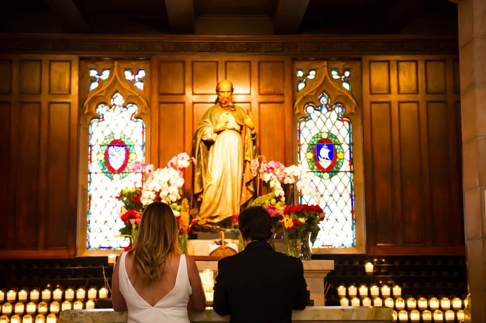 Bride and Groom praying inside of Saint Dominic's Church in San Francisco