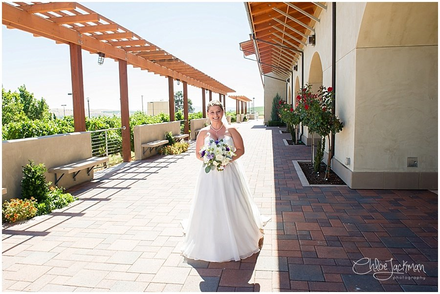 bride holding bouquet by Delford West Flowers outside of Garre Winery Wedding in Livermore