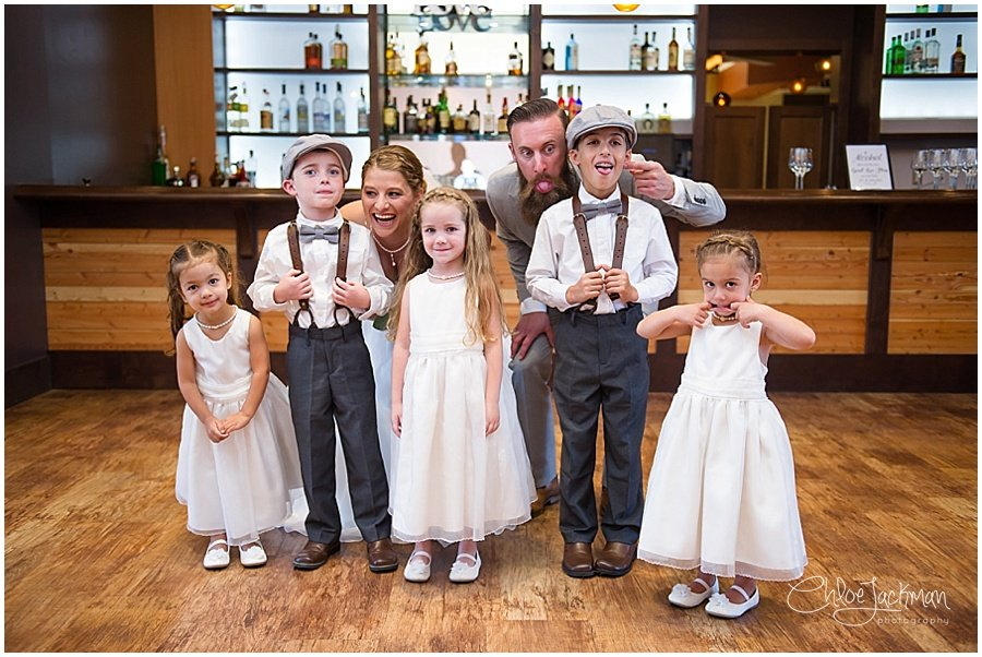 bride and groom with flower girls and ring bearers