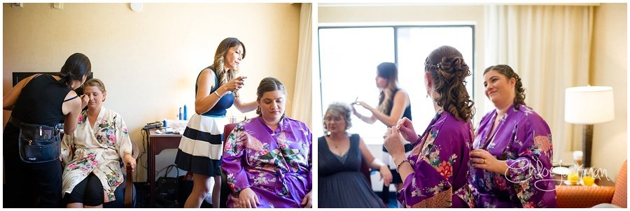 bride and bridesmaid getting hair and makeup done