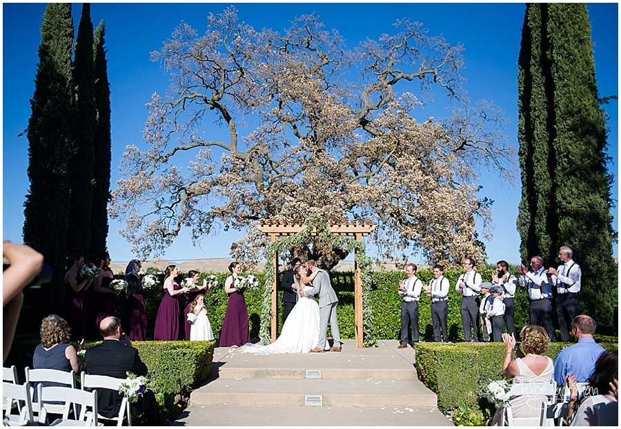 bride and groom first kiss at their outdoor Garre Winery Wedding in Livermore