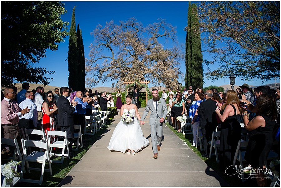 bride and groom walk down the aisle at their outdoor Garre Winery Wedding in Livermore
