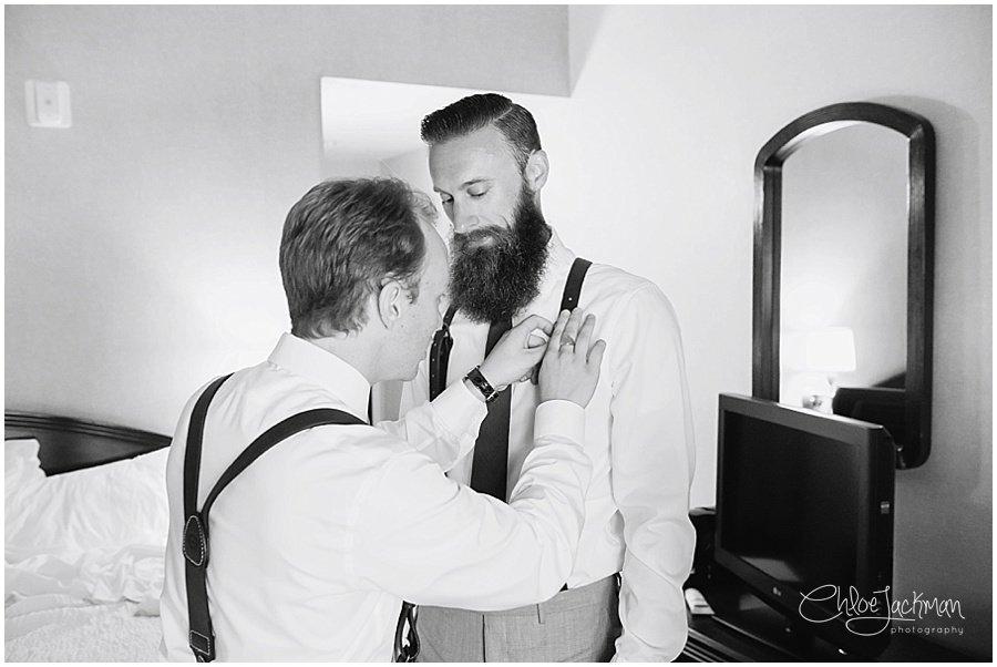 groom getting ready with groomsman