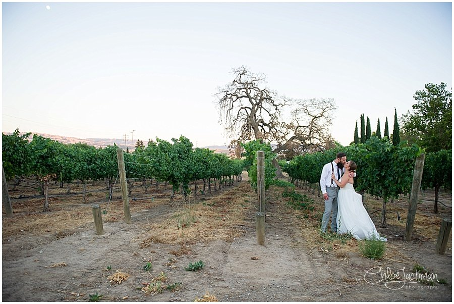 bride and groom embracing outside of Garre Winery Wedding in Livermore