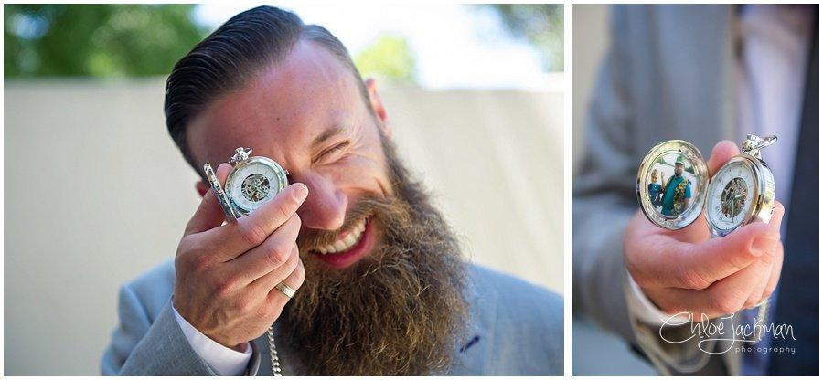 groom holding pocket watch