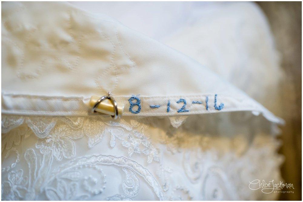 wedding date sewn into wedding dress