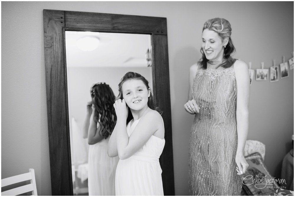 maid of honor and flower girl getting ready