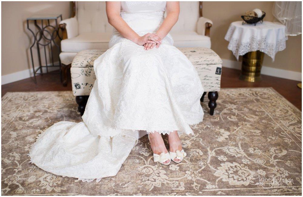 bride sitting down wearing kate spade shoes