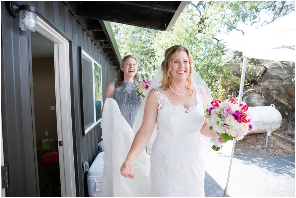bride walking towards aisle with wedding bouquet by Accents by Sage