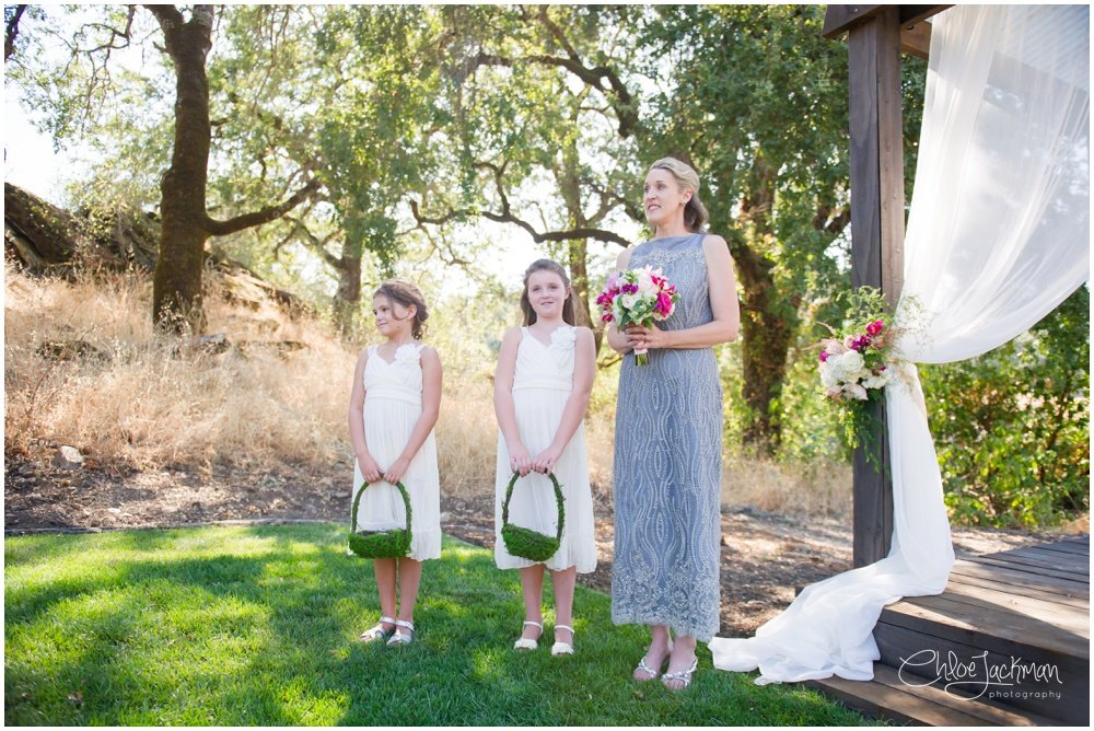 maid of honor and flower girls at the altar