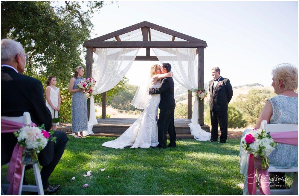 bride and groom kiss at highlands estate wedding