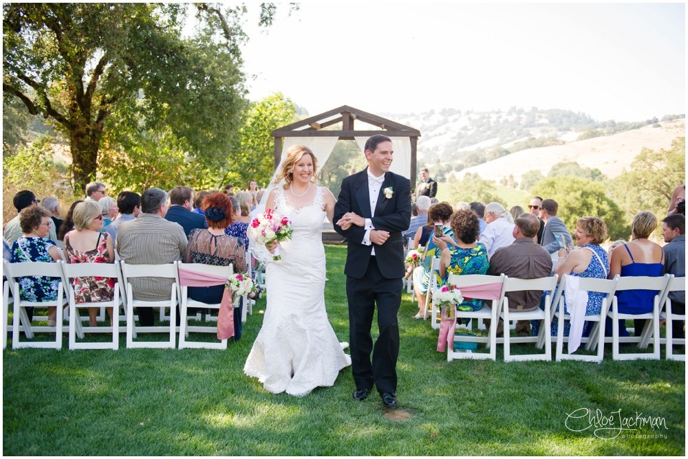 bride and groom walk down the aisle at highlands estate wedding