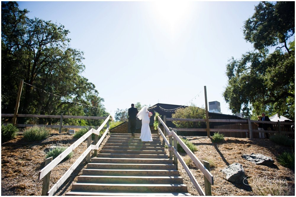 bride and father walking down the aisle at highlands estate wedding