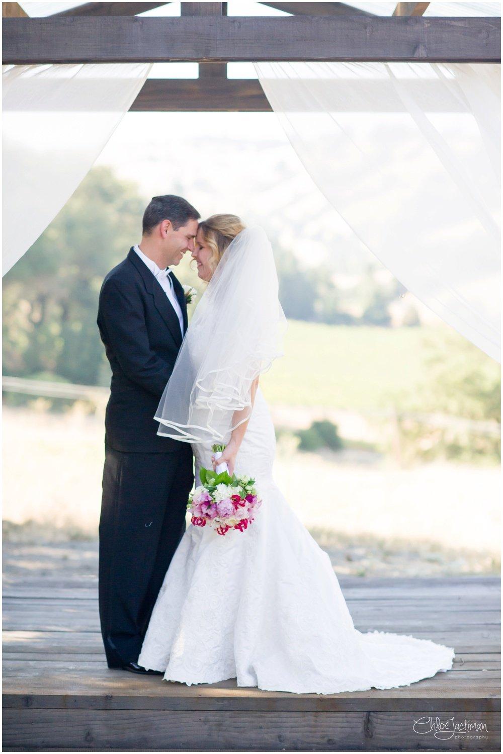 bride and groom embracing at highlands estate wedding
