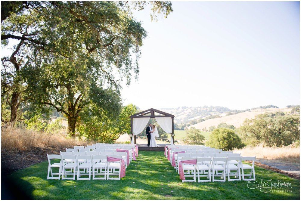 bride and groom at the altar at highlands estate wedding