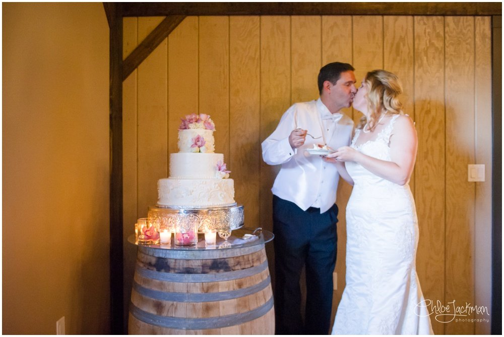 bride and groom cutting wedding cake by Preferred Sonoma Caterer