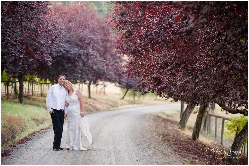 bride and groom embracing outside at highlands estate wedding