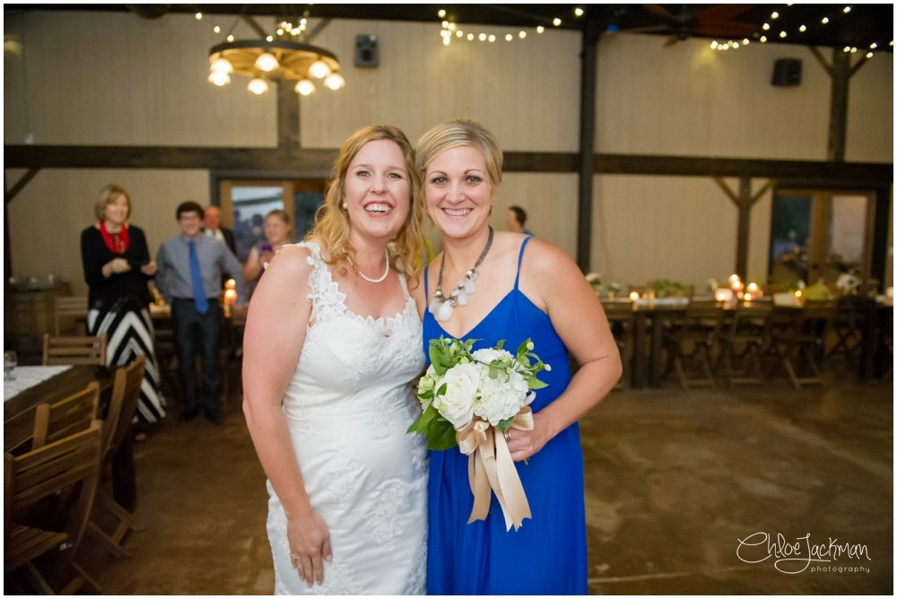 bride and wedding guest with bouquet by Accents by Sage
